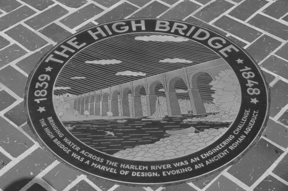 One of many commemorative plaques on the High Bridge.