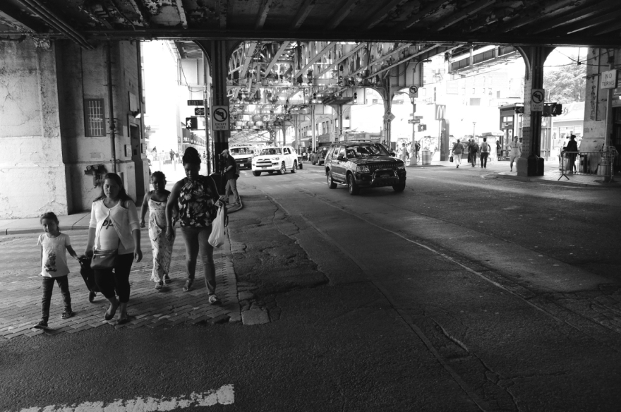 Under the El on Jerome Avenue.
