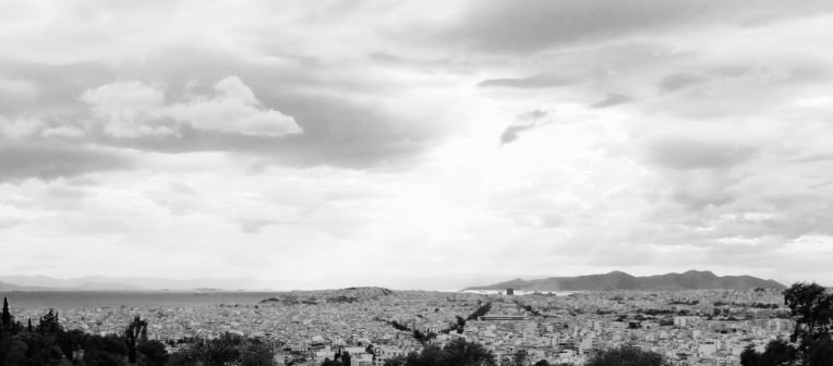 Sprawling Athens, looking south from Fillopappa hill, to Aegina Island.